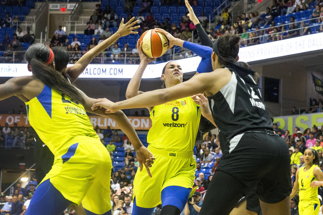 Dallas Wings center Liz Cambage (8) attempts to shoot a basket over Las Vegas forward A'ja Wils ...
