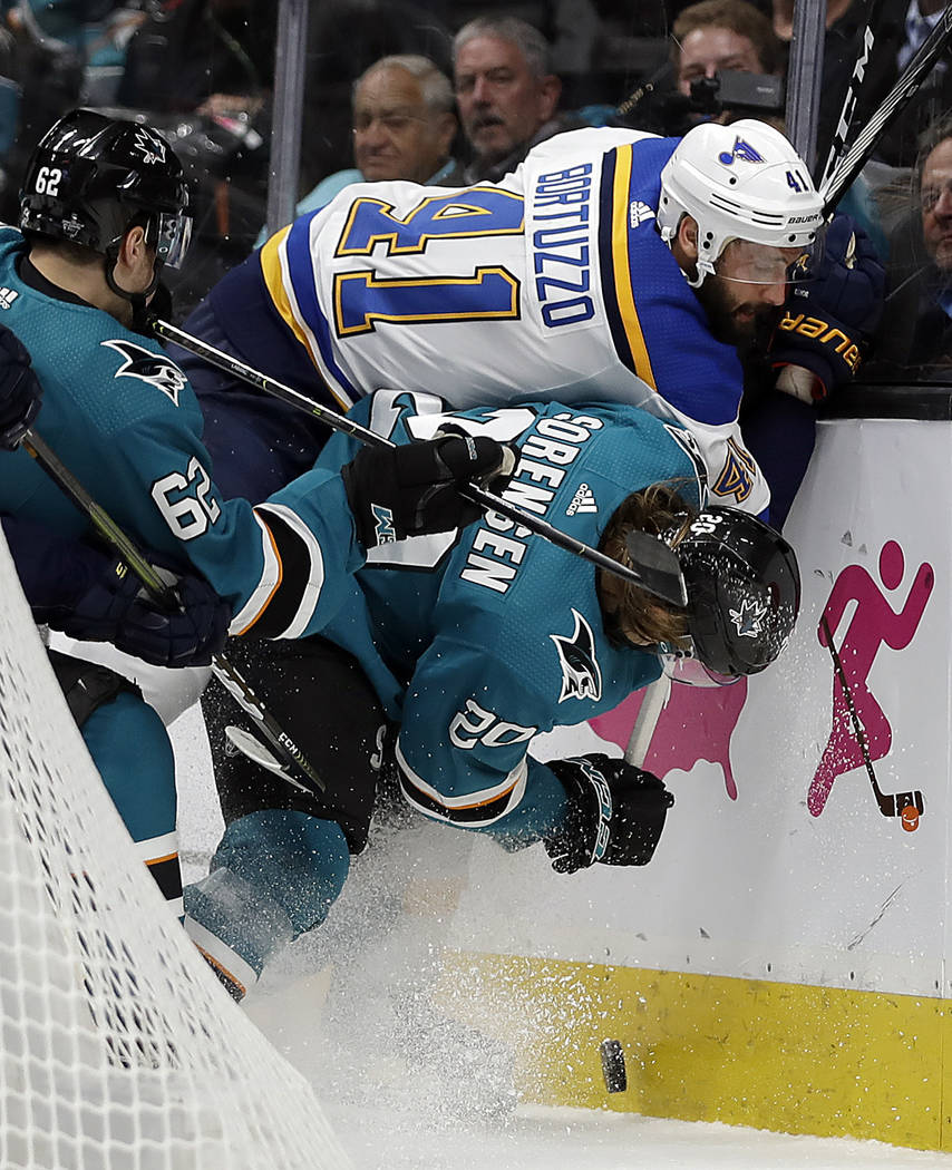 St. Louis Blues' Robert Bortuzzo (41) fights for the puck with San Jose Sharks' Kevin Labanc, l ...
