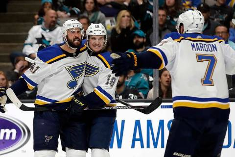 St. Louis Blues' Robert Bortuzzo, left, celebrates with teammates Robert Thomas (18) and Pat Ma ...