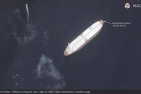 This satellite image provided by Maxar Technologies shows the Saudi-flagged oil tanker Amjad of ...