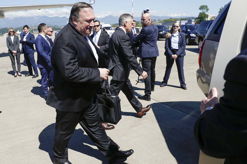 U.S. Secretary of State Mike Pompeo walks from the plane upon his arrival at the airport in the ...