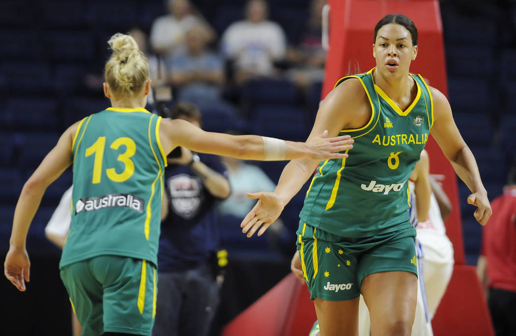 Australia's Elizabeth Cambage slaps hands with teammate Erin Phillips, left, during the first h ...