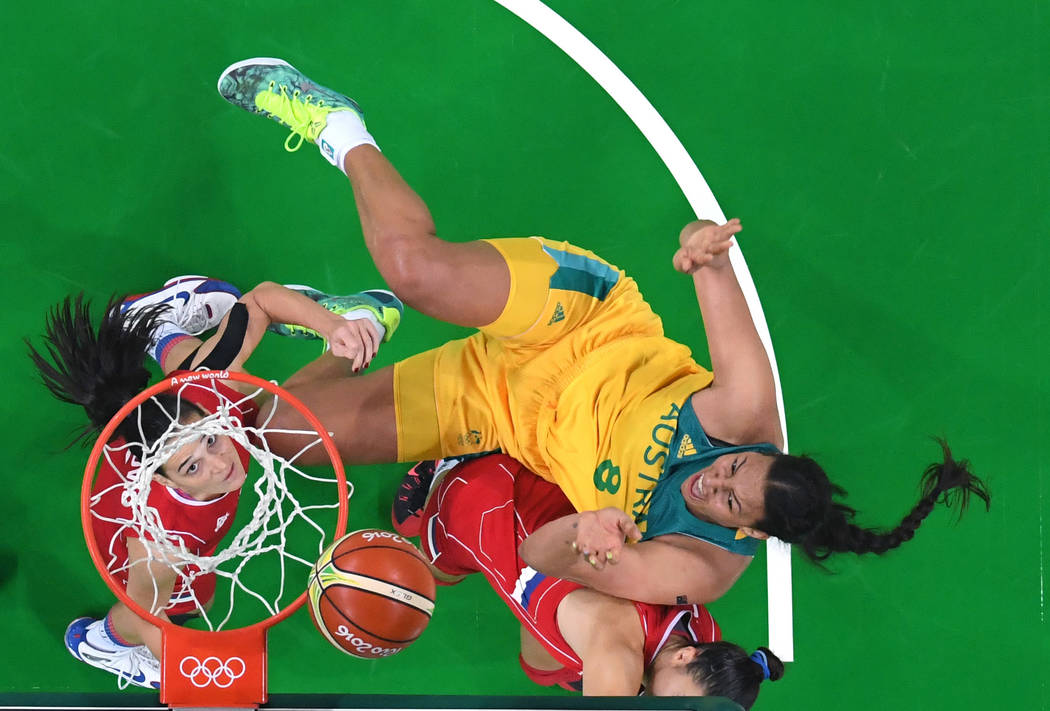 Australia's Elizabeth Cambage (8) shoots against Serbia during a women's basketball game at the ...