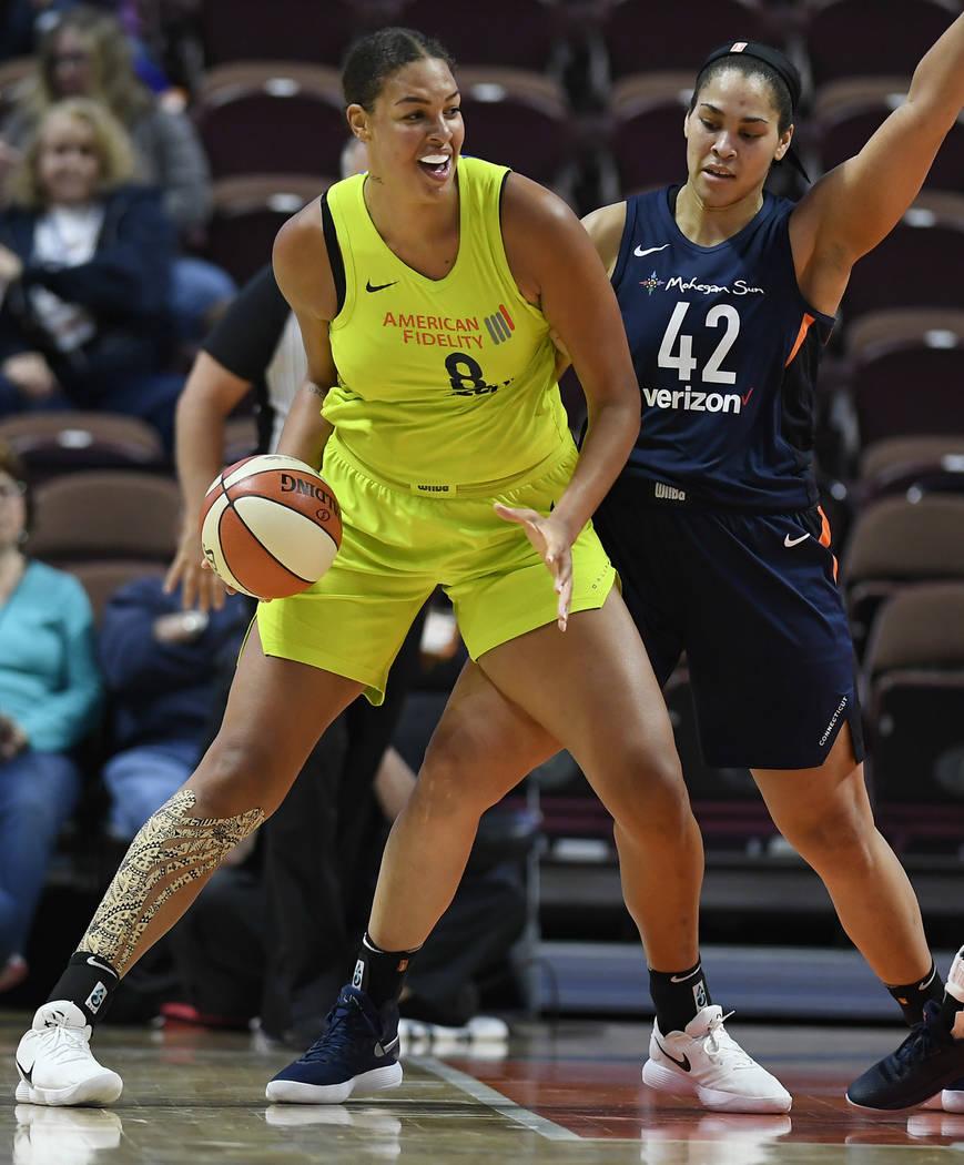 Dallas Wings' Liz Cambage, left, and Connecticut Sun's Brionna Jones during a preseason WNBA ba ...