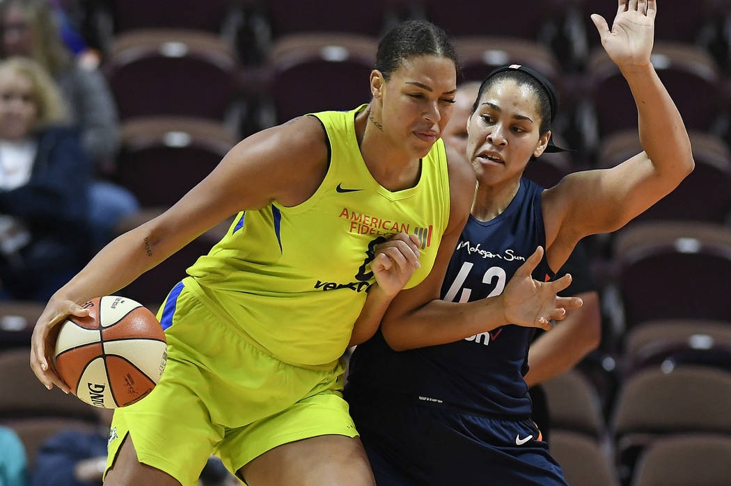 In this May 8, 2018, file photo, Dallas Wings' Liz Cambage, left, drives against Connecticut Su ...