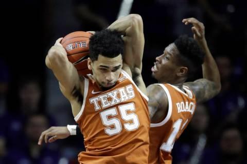 Texas guard Elijah Mitrou-Long (55) and Texas guard Kerwin Roach II (12) during the first half ...