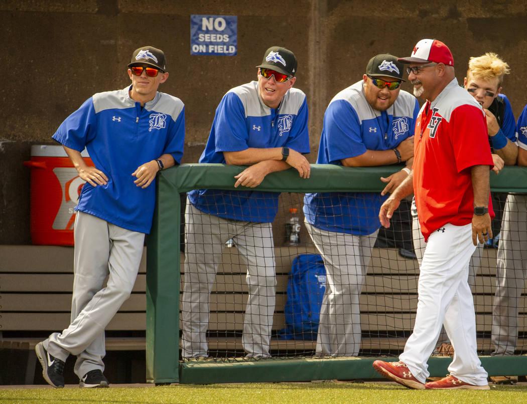 Longtime Las Vegas High coach Sam Thomas (right) talks up Basic coaches at an inning change dur ...