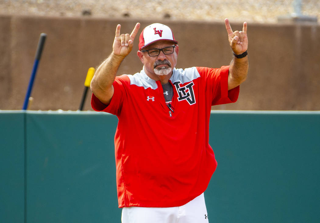 Longtime Las Vegas High coach Sam Thomas signals a player at first base during their state base ...