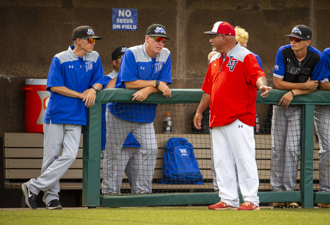 Longtime Las Vegas High coach Sam Thomas (right) talks up Basic coaches at an inning change dur ...