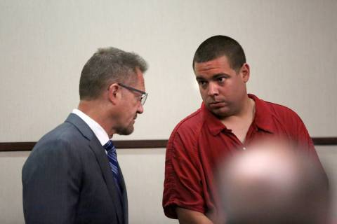 Matthew James Terry, right, a Las Vegas police officer arrested on suspicion of lewdness with a ...