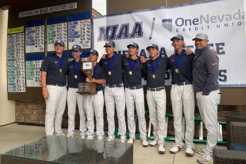 Coronado's boys golf team poses with the trophy after winning the Class 4A state championship a ...