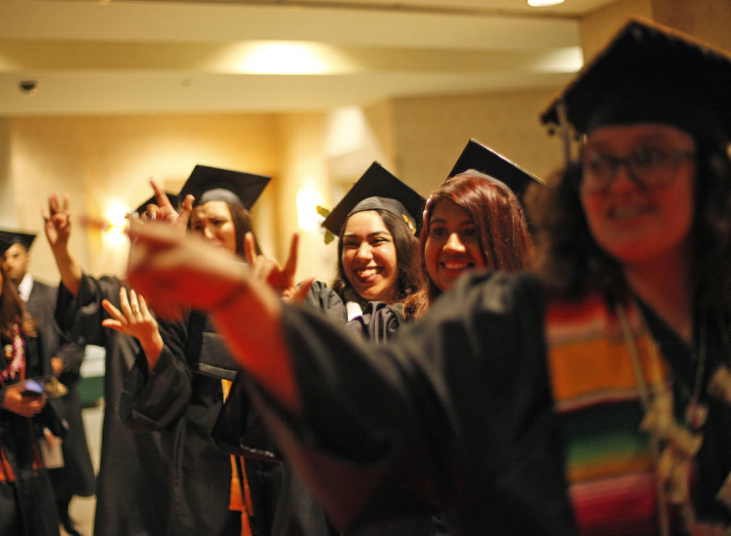 "Students of the first graduating class for the new Deaf Studies program show signs of ""I l ..."