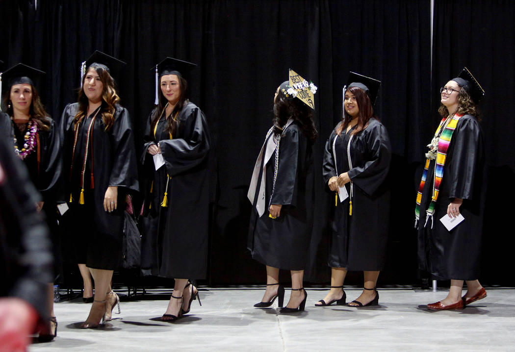 Students of the first graduating class for the new Deaf Studies program prepare to receive thei ...
