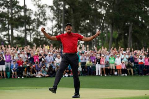 In this Sunday, April 14, 2019, file photo, Tiger Woods reacts as he wins the Masters golf tour ...