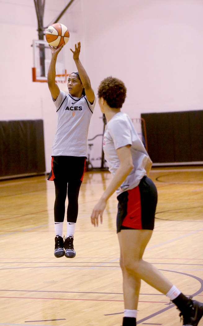 Veteran guard Sydney Colson shoots over Isabelle Harrison during practice at the Cox Pavilion i ...