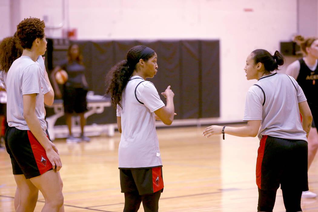 Veteran guard Sydney Colson, center, talks to teammate Saniya Chong during practice at the Cox ...