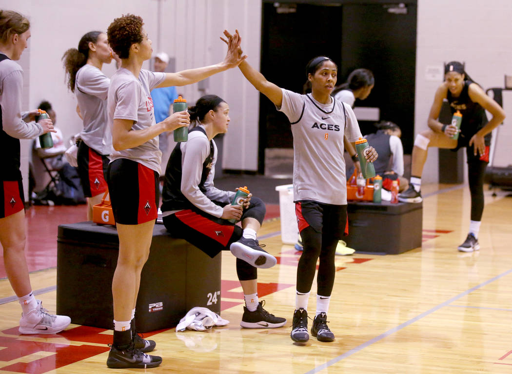 Veteran guard Sydney Colson, right, high-fives Isabelle Harrison during practice at the Cox Pav ...