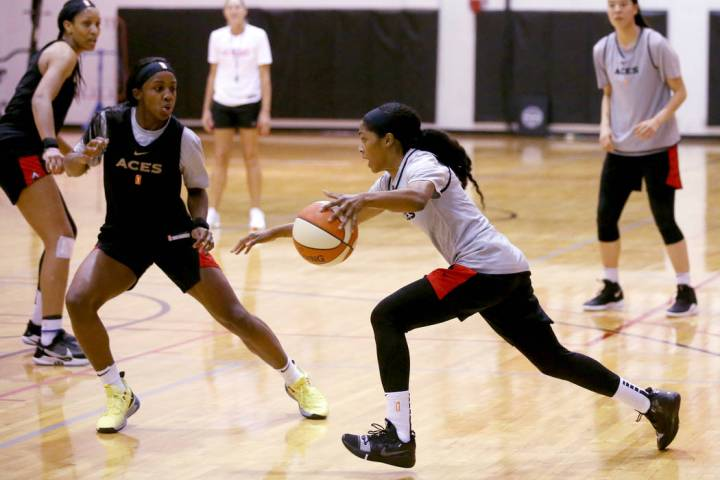 Veteran guard Sydney Colson drives on Jackie Young as A'ja Wilson, left, and JiSu Park look on ...