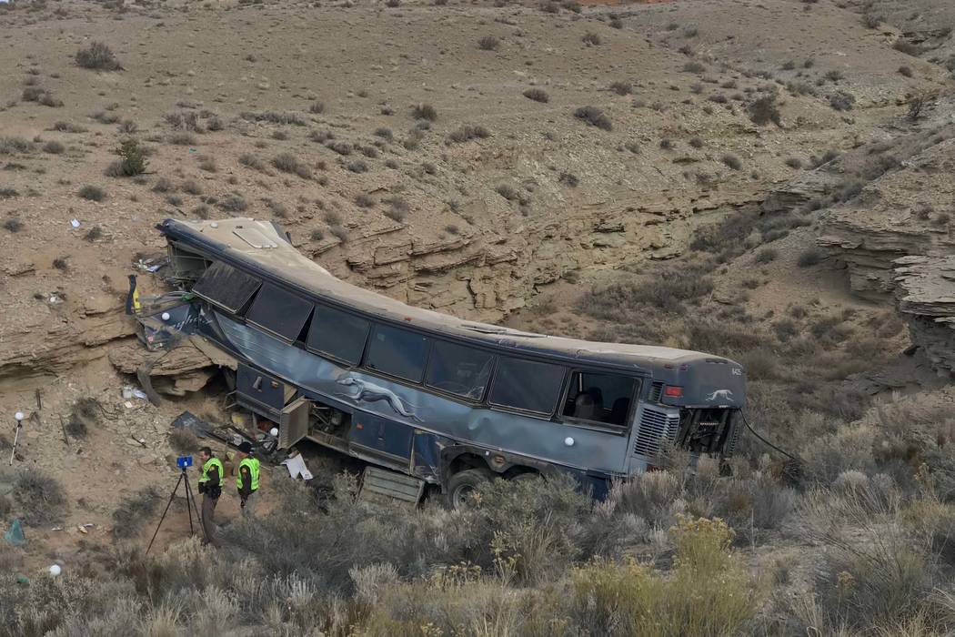 The aftermath of a late-Sunday Greyhound bus crash is seen on Monday, Jan. 1, 2018 in Emery Cou ...