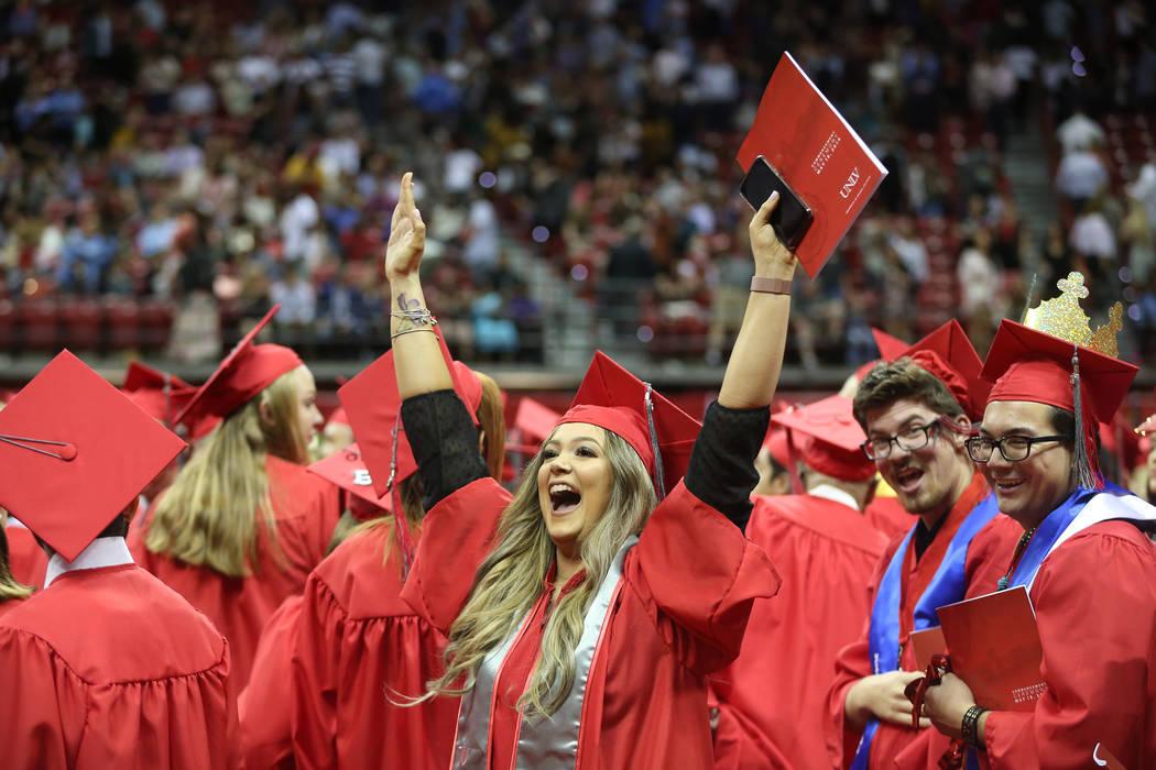 Psychology major Sharon Kotler, 23, center, of Las Vegas, celebrates at the end of the program ...