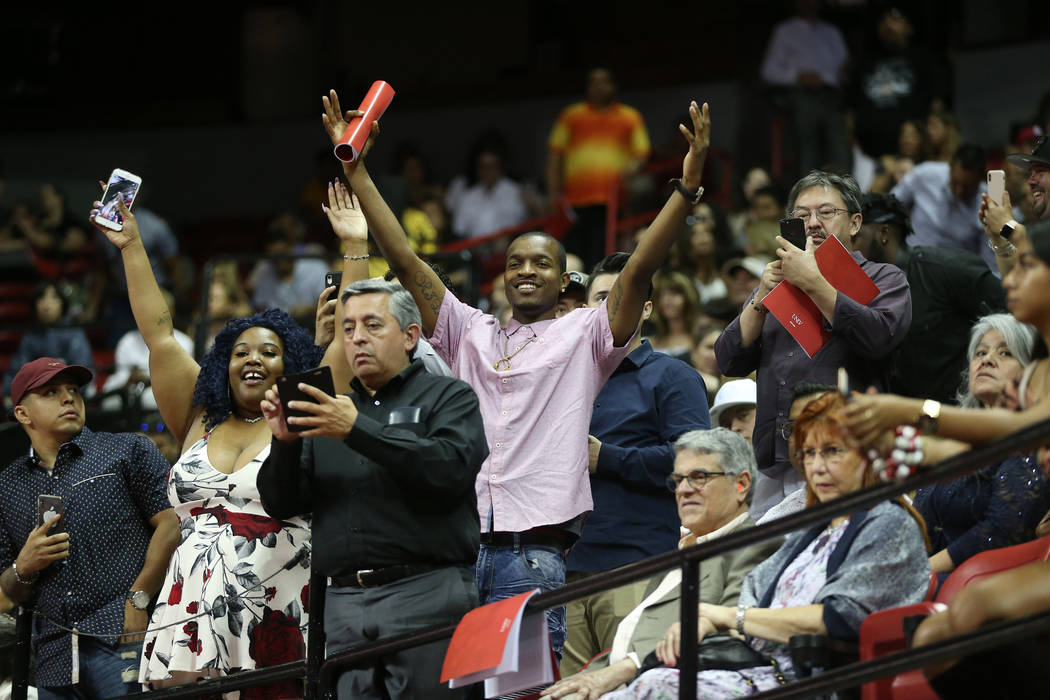People wave at graduates during the UNLV commencement ceremony at the Thomas & Mack Center ...