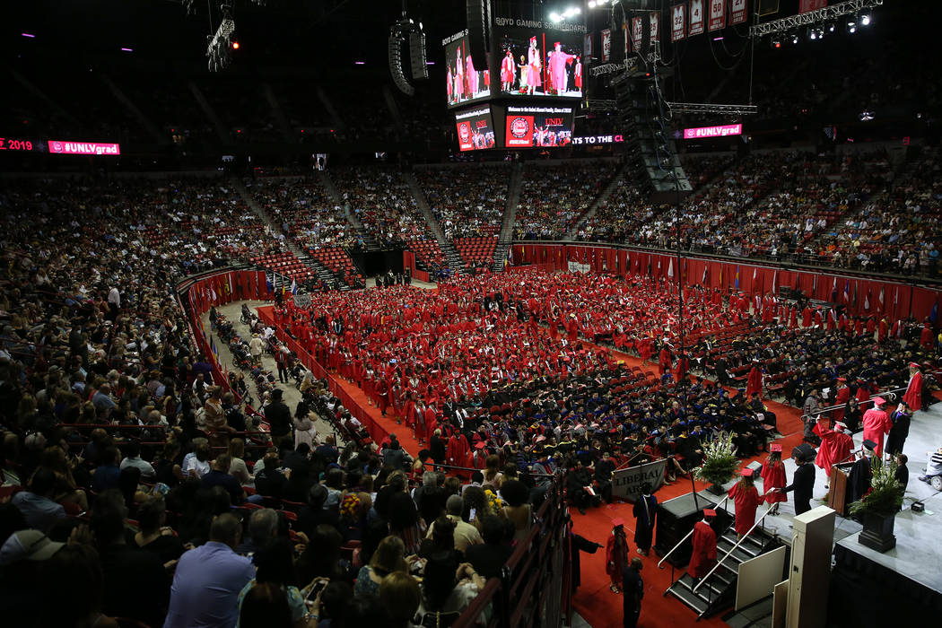 Students participate during the UNLV commencement ceremony at the Thomas & Mack Center in L ...