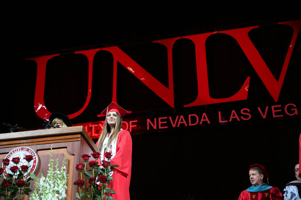 Economics and political science major graduate Ashley is recognized during the UNLV commencemen ...