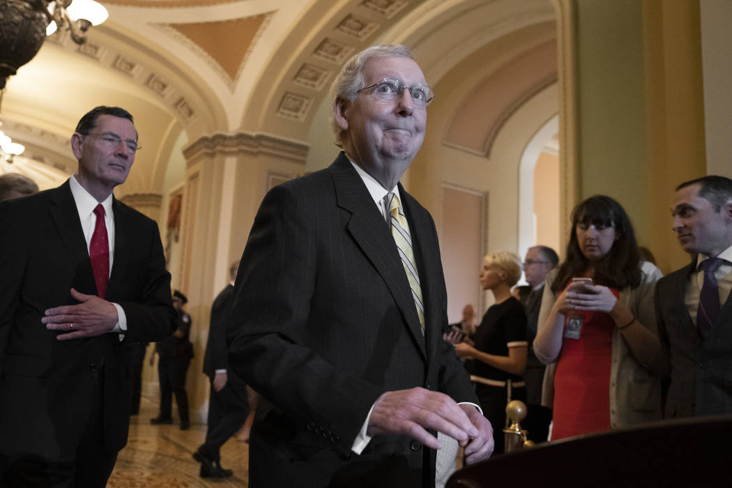 Senate Majority Leader Mitch McConnell, R-Ky., joined at left by Sen. John Barrasso, R-Wyo., an ...