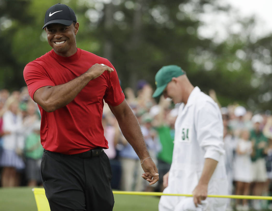 Tiger Woods reacts as he wins the Masters golf tournament Sunday, April 14, 2019, in Augusta, G ...