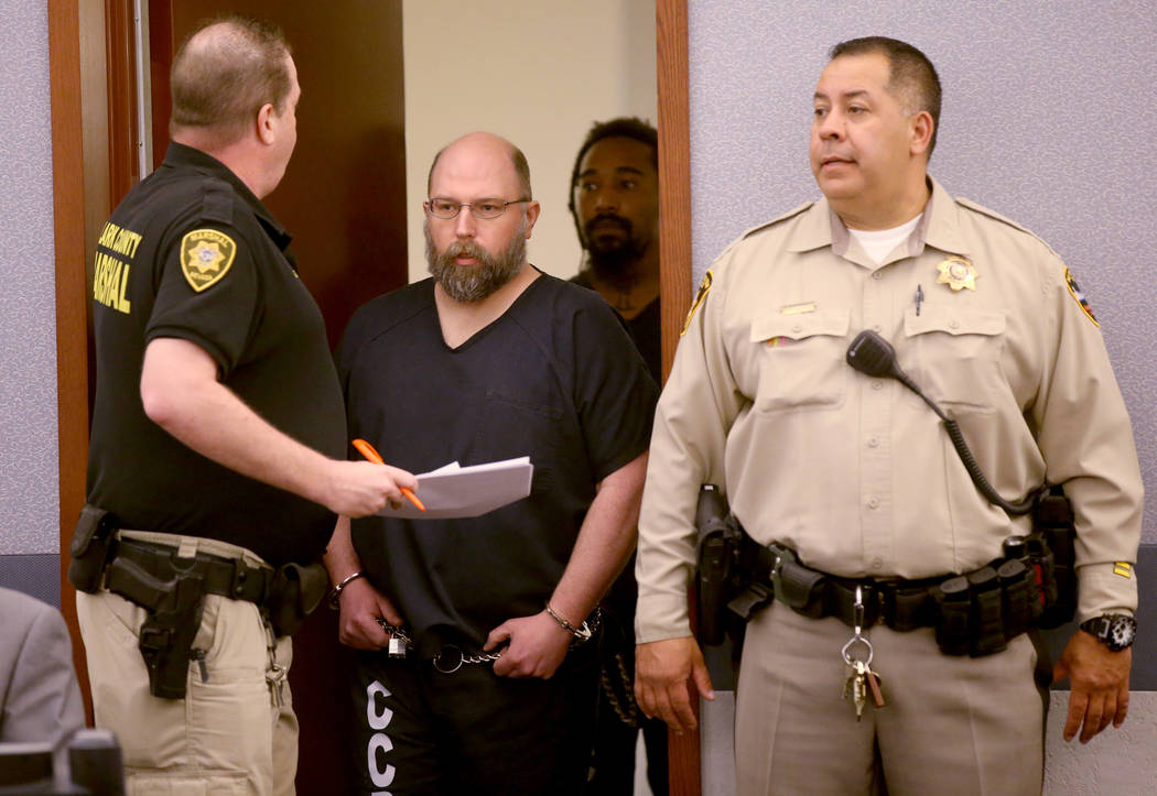Former Las Vegas Police officer Bret Theil is led into the courtroom at the Regional Justice Ce ...