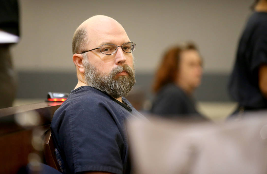Former Las Vegas Police officer Bret Theil waits in the courtroom at the Regional Justice Cente ...