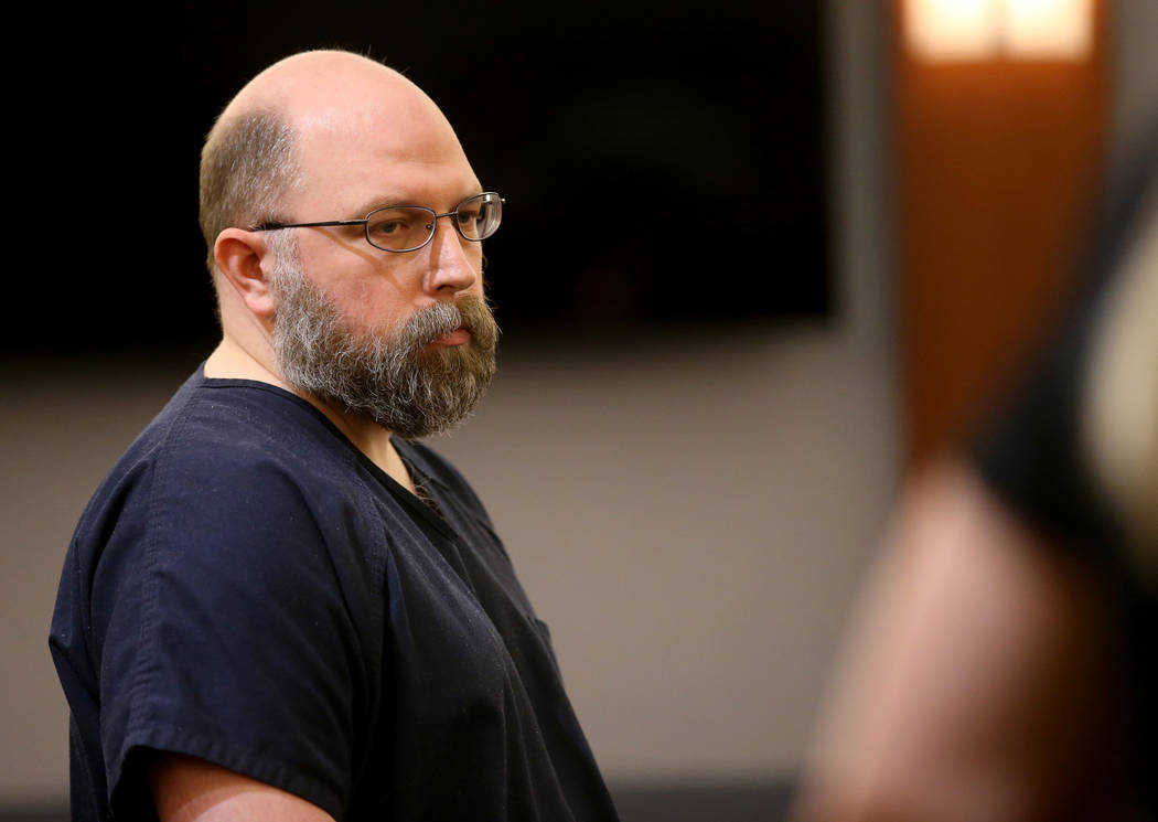 Former Las Vegas Police officer Bret Theil listens to his victim read a statement at the Region ...