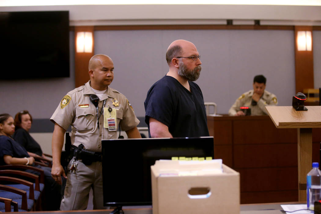 Former Las Vegas Police officer Bret Theil is led out of the courtroom at the Regional Justice ...