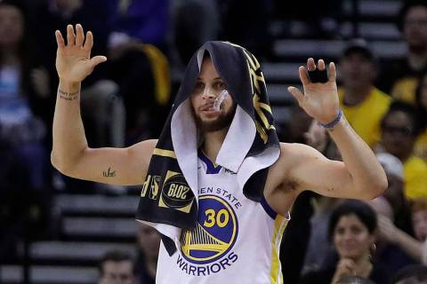 Golden State Warriors' Stephen Curry celebrates a teammate's score during the second half of Ga ...