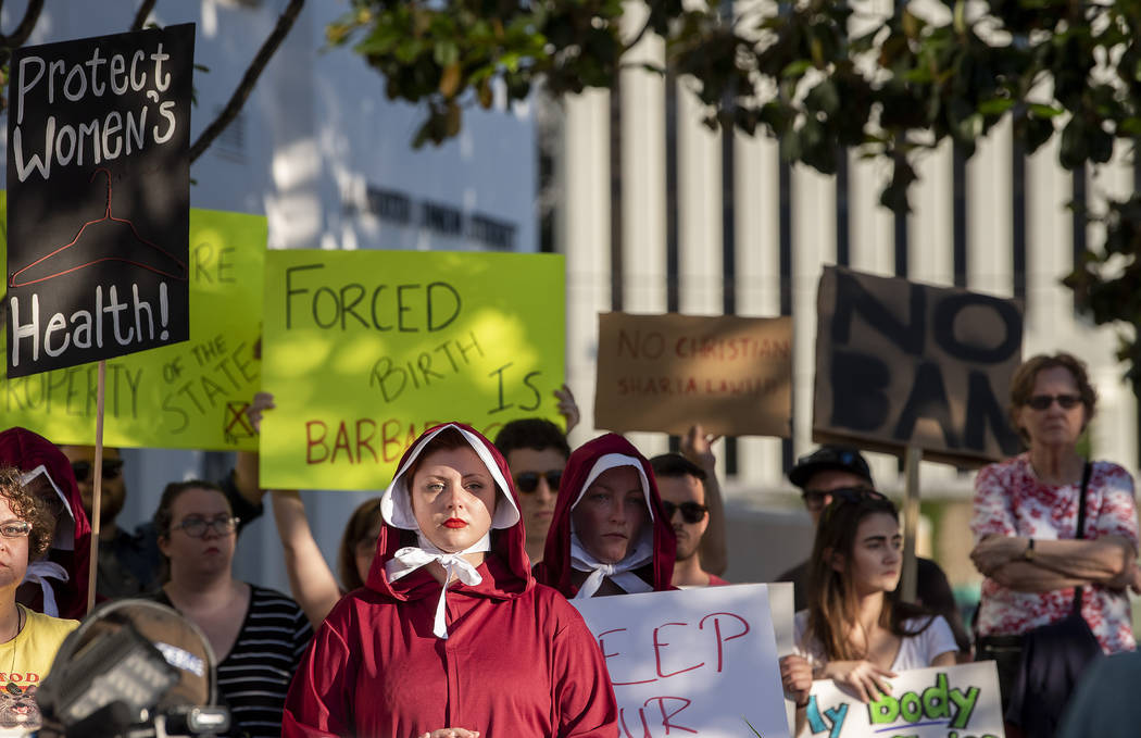 Margeaux Hartline, dressed as a handmaid, during a rally against HB314, the near-total ban on a ...