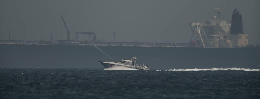 An Emirati coast guard vessel passes an oil tanker off the coast of Fujairah, United Arab Emira ...