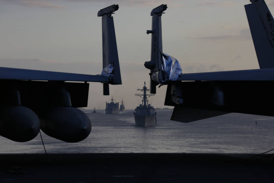 In this Thursday, May 9, 2019 photo released by the U.S. Navy, the Abraham Lincoln Carrier Stri ...