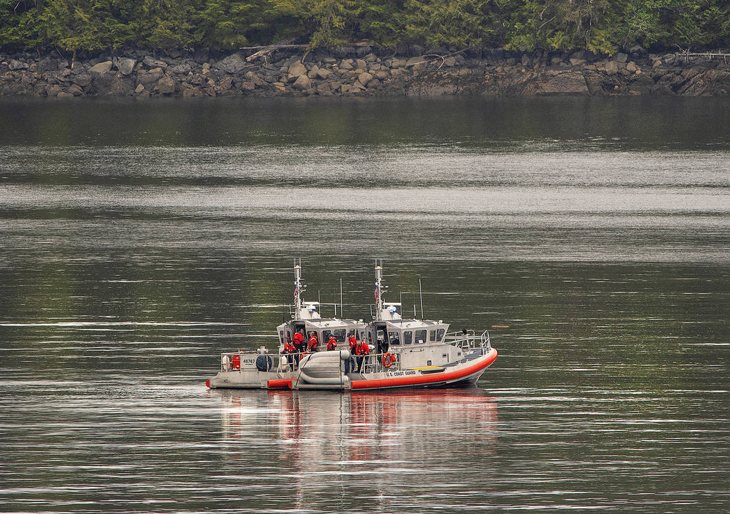 Two U.S. Coast Guard 45-foot response boats drift through George Inlet as part of a search effo ...
