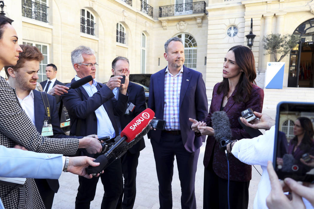 New Zealand Prime Minister Jacinda Ardern, right, gives a press conference, at the OECD headqua ...