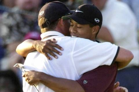 Tiger Woods hugs caddie, Steve Williams, after winning the PGA Championship on Sunday, Aug. 20, ...
