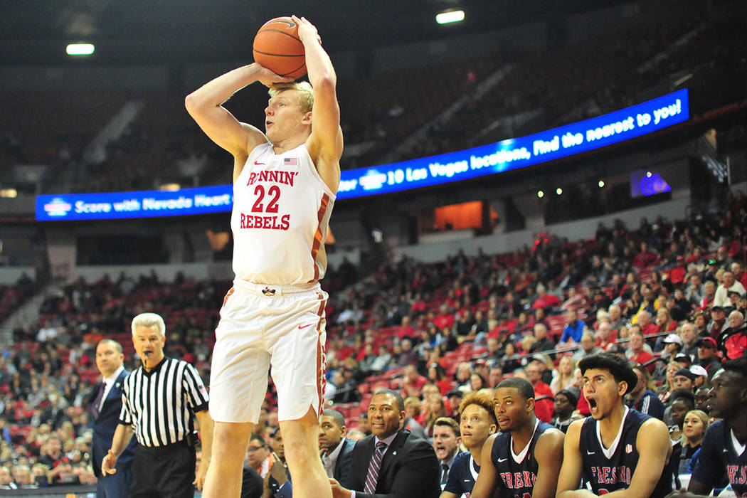 UNLV Rebels guard Trey Woodbury (22) takes a three-point shot during the first half of a game b ...
