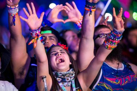 Festivalgoers dance to the sounds of American DJ Kaskade on day one of the Electric Daisy Carni ...
