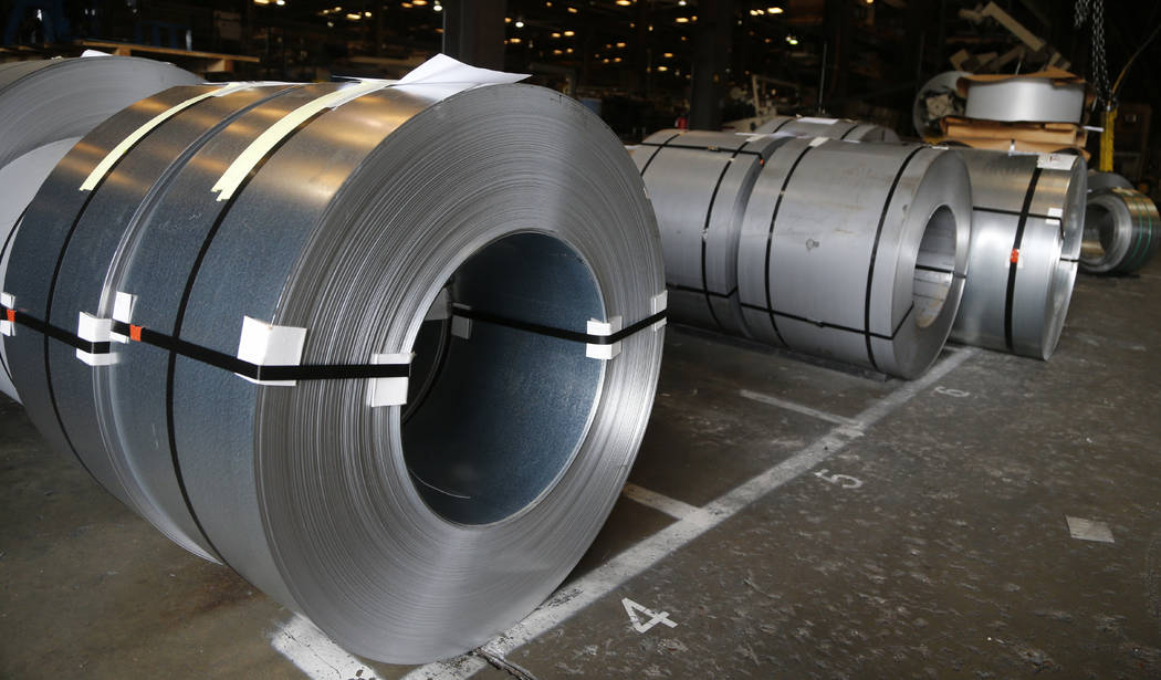 FILE - In this July 11, 2018, file photo rolls of steel sit in a warehouse at a fabrication com ...