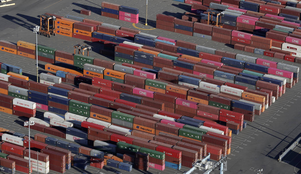 FILE - In this March 5, 2019, file photo, cargo containers are staged near cranes at the Port o ...