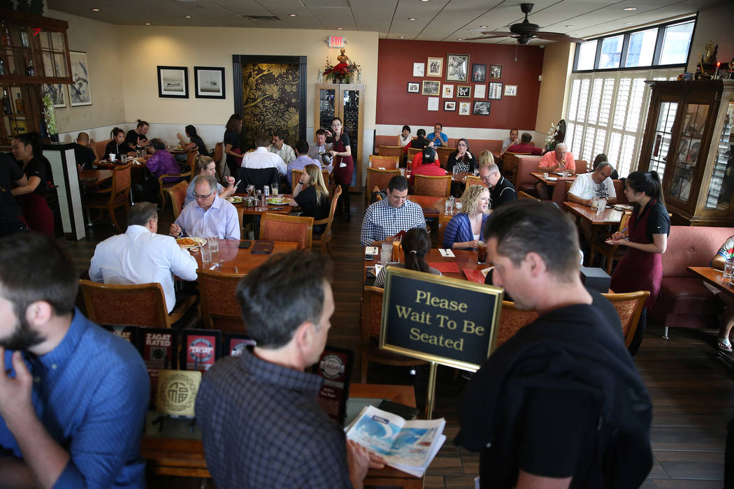 Customers wait in line to be seated during lunch at Archi's Thai Bistro in Las Vegas, Thursday, ...