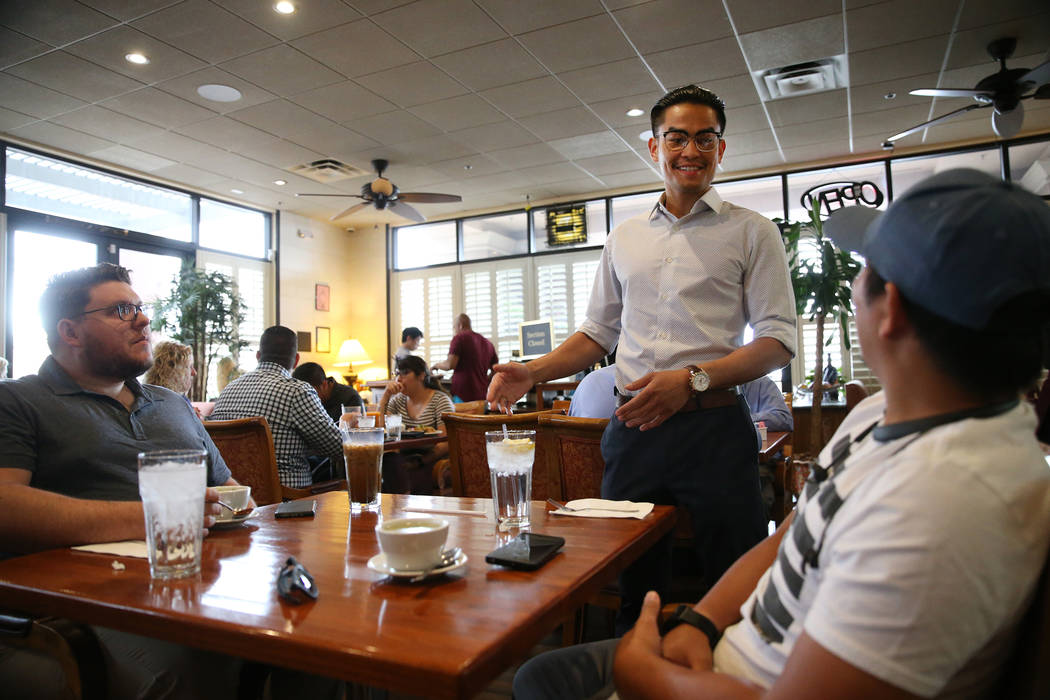 Ronnakon Silpasuvun, center, owner of Archi's Thai Bistro, speaks with Cameron Belt, left, and ...