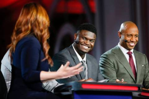 Duke's Zion Williamson second from right, is interviewed by an ESPN reporter during the NBA bas ...