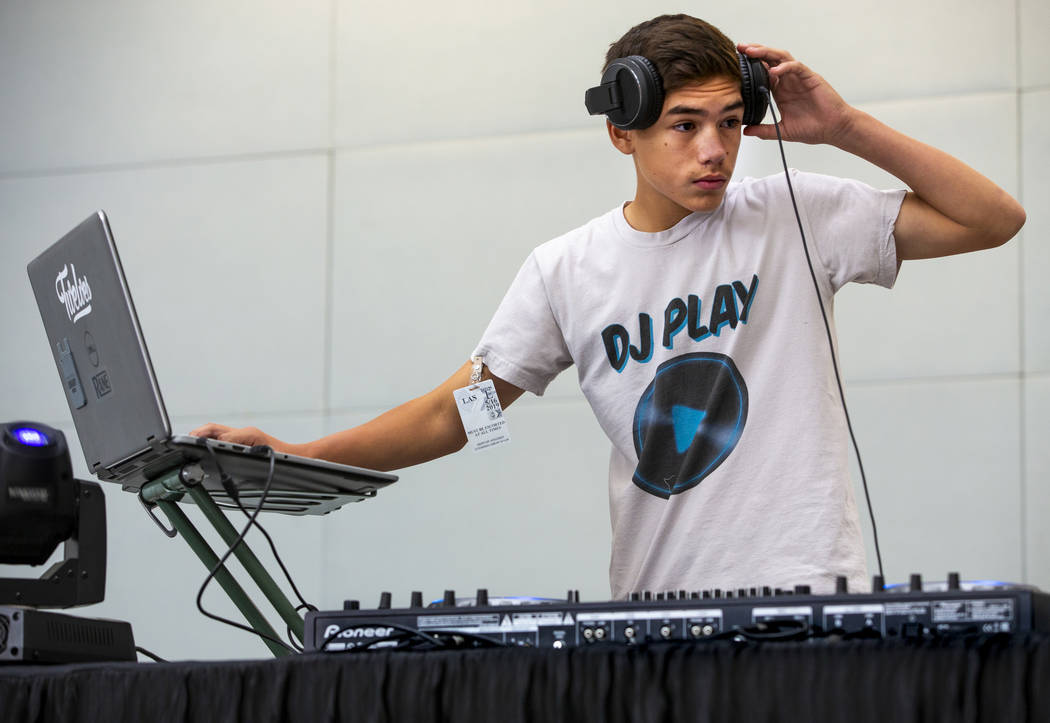 DJ Play performs for travelers including EDC visitors arriving through Terminal 3 at McCarran I ...