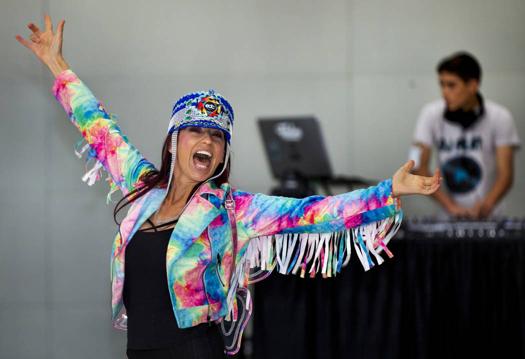 EDC traveler CarolinaWoodruff of Jacksonville, Florida, dances as DJ Play performs for visitors ...