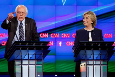 In this Tuesday, Oct. 13, 2015, file photo, Sen. Bernie Sanders, of Vermont, left, speaks as Hi ...
